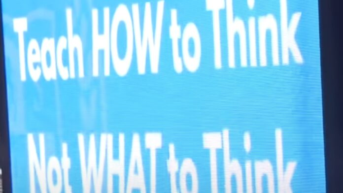 Parents Place Anti-Woke Signs: Teach HOW to Think Not WHAT to Think...