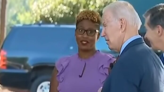 Watch Biden's Awkward Moment at a Staged Photo Opp...