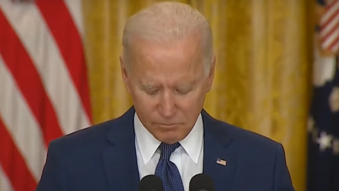 Must See Biden Checks His Phone During Moment of Silence...