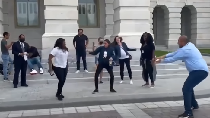 Watch AOC Dance and then 'Mask Up' for Photo Op...