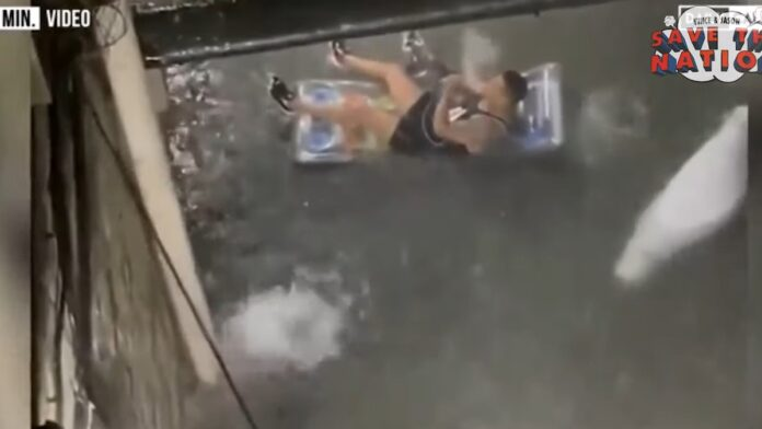 NY Man Smoking Large Pipe Caught Floating Down Flooded Streets...